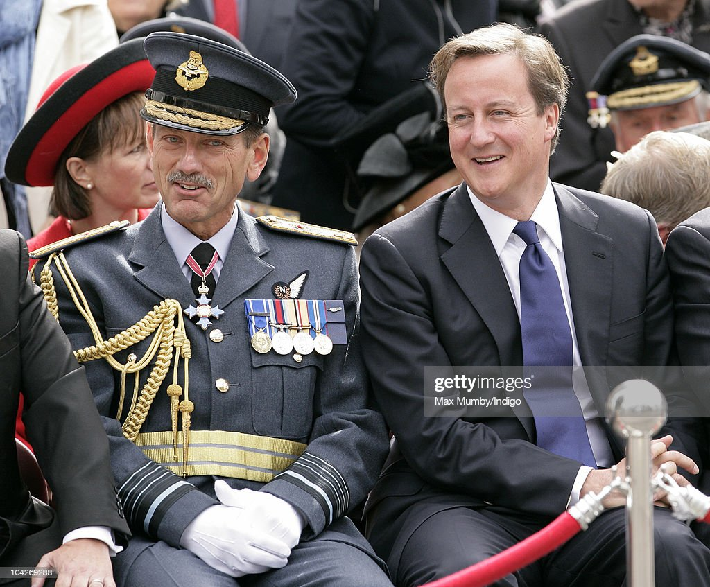 Air Chief Marshal Simon Bryant, Commander-in-Chief Air Command and Prime Minister <a gi-track='captionPersonalityLinkClicked' href=/galleries/search?phrase=David+Cameron+-+Politician&family=editorial&specificpeople=227076 ng-click='$event.stopPropagation()'>David Cameron</a> watch the parade and flypast as they attend the Battle of Britain 70th Anniversary Service at Westminster Abbey on September 19, 2010 in London, England.