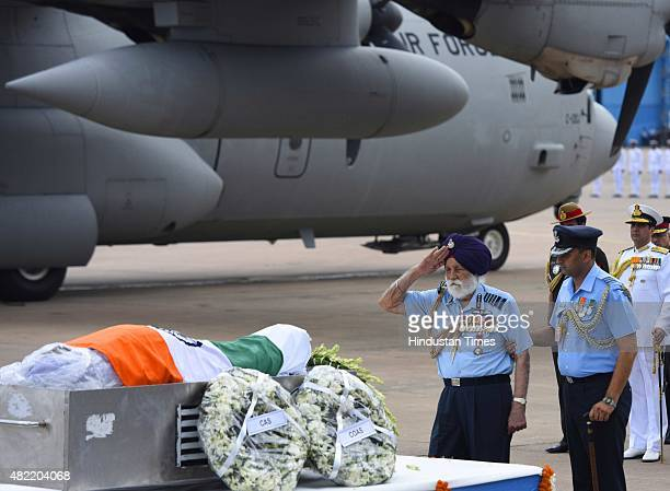 Air Chief Marshall Sardar Arjan Singh salutes as he pays his last tribute to the body of the former President of India A P J Abdul Kalam wrapped with...
