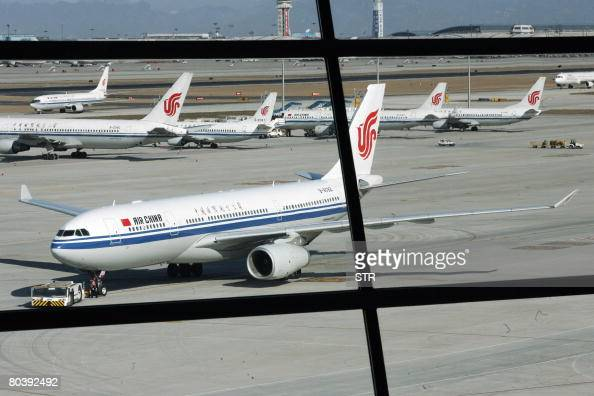 Air China's jetliners move onto the tarmac of the new jumbo Terminal 3 at the Beijing Capital International Airport in Beijing on March 26 2008...