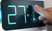 Air Conditioner Temperature Control. Finger pressing the thermometer icon on the scrren, Celsius unit. Home Automation Concept. Composite between an image and a 3D background