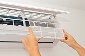 Changing the filter in the air conditioner. The concept of safe and healthy housing