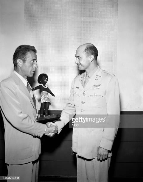 Actor Humphrey Bogart receives a Fuzzy Wuzzy award on the Army Hour broadcast for favorite actor from Col Joseph McMicking Photo by NBCU Photo Bank
