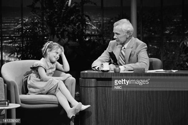 CARSON Air Date Pictured Actress Drew Barrymore host Johnny Carson Photo by Gene Arias/NBCU Photo Bank
