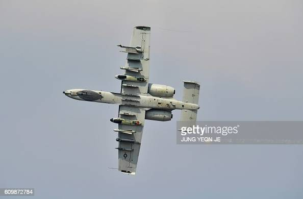 US Air Force A10 Thunderbolt performs during 'Air Power Day' preview at US Osan Air Base in Pyeongtaek on September 23 2016 An American strategic...