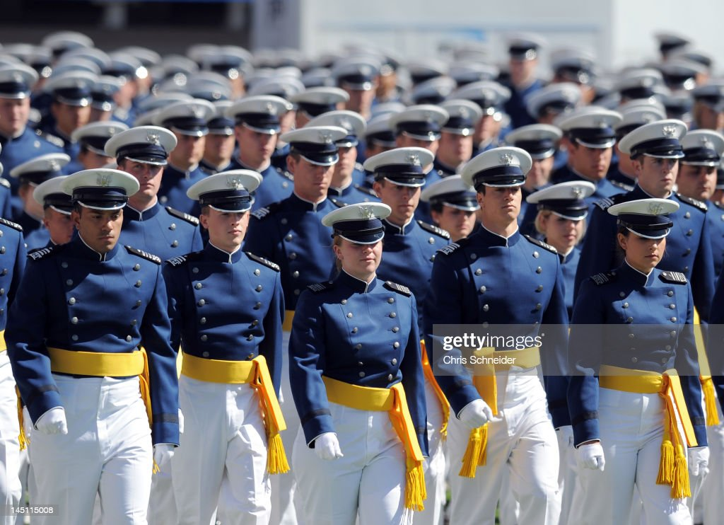 Air Force Academy Cadet graduates walk onto the field at the start of the graduation ceremony for the US Air Force Academy at Falcon Stadium on May...