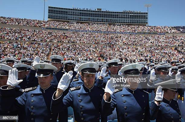 Air Force Academy graduates take the oath of office after receiving their diplomas at the US Air Force Academy graduation ceremony at Falcon Stadium...