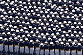 Members of the U.S. Air Force Academy Class of 2007 salute during the playing of the national anthem during the commencement ceremony May 30 in Colorado. The ceremony marks the culmination of four yea