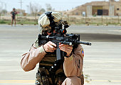 April 8, 2009 - U.S. Air Force Airman conducts security at an airbase in Iraq during airlift operations in support of Operation Iraqi Freedom.