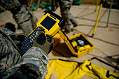 May 5, 2011 - U.S. Air Force Airman uses a satellite base station on a rooftop to collect data on terrain features and distances at Contingency Operating Site Kalsu in Iraq, for the construction of a