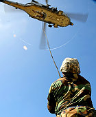 April 23, 2009 - U.S. Air Force airmen conduct rappelling and fast-roping techniques during their field training exercise at Northwest Field, Andersen Air Force Base, Guam.