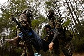 U.S. Air Force Airmen from the 437th Airlift Wing carry a simulated casualty to a secure location during a mock gas attack as part of an expeditionary combat skills training (ECST) course at Charleston Air Force Base in South Carolina December 7, 2006.