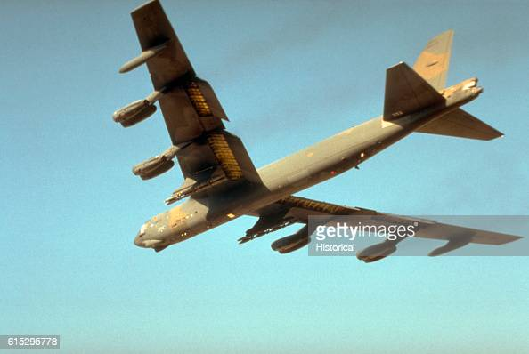A US Air Force B52G Stratofortress aircraft takes off on a mission in support of Operation Desert Storm The aircraft is armed with bombs on the wing...