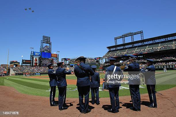 Air Force band plays the national anthem as Air Force fighter pilots perform a fly by as the Houston Astros prepare to face the Colorado Rockies on...