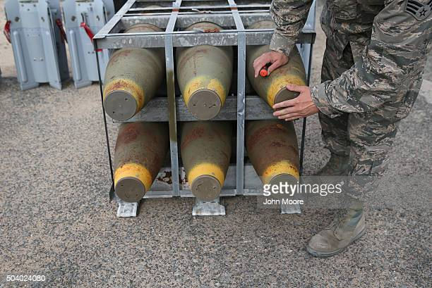 S Air Force bombs lie at an outdoor storage facility on January 8 2016 at a base in the Persian Gulf Region The US military and coalition forces use...