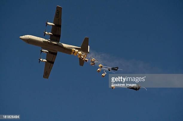 A U. S. Air Force C-130 Hercules airdrops 20 bundles over Afghanistan.