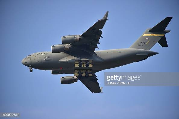 US Air Force C17 Globemaster cargo jet makes a landing during 'Air Power Day' preview at US Osan Air Base in Pyeongtaek on September 23 2016 An...