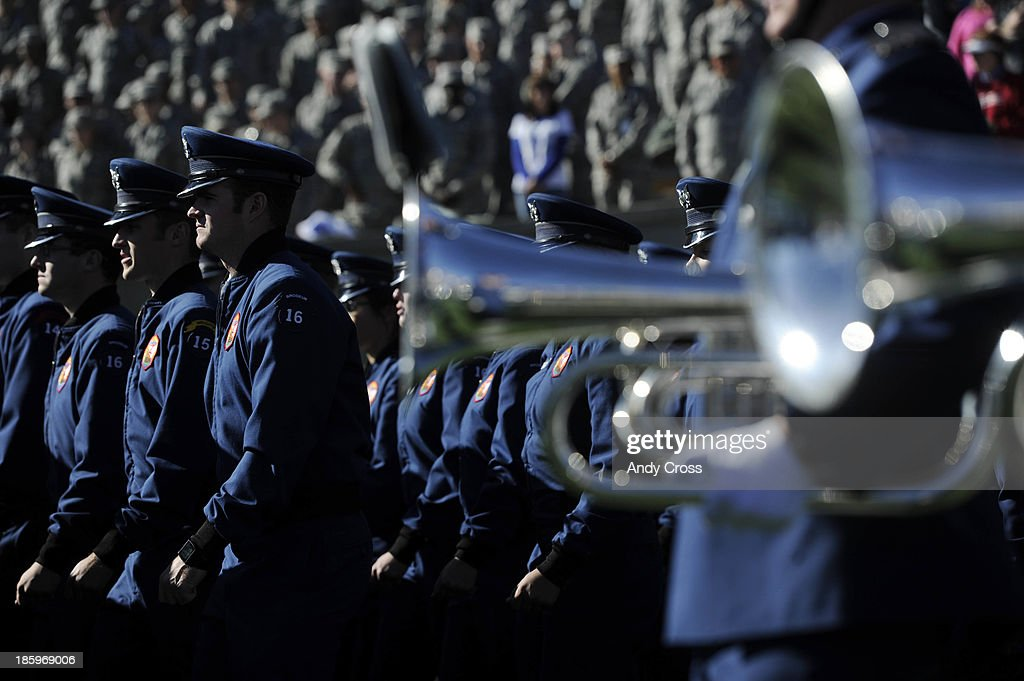 Air Force cadets take the field before entering the stands before the Falcons battled the Notre Dame Fighting Irish at Falcon Stadium, Saturday afternoon, October 26, 2013.