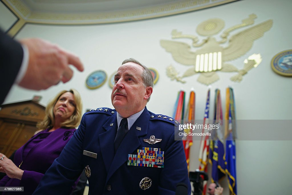S Air Force Chief of Staff Gen Mark Welsh III and Air Force Secretary Deborah Lee James prepare to testify before the House Armed Services Committee...