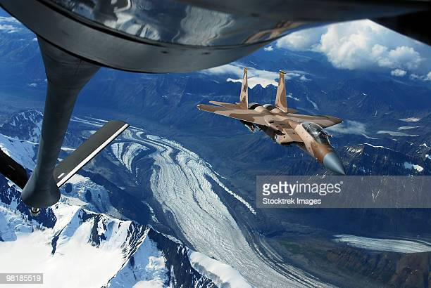 A U.S. Air Force F-15C Eagle positioning itself behind a KC-135R Stratotanker over Alaska.