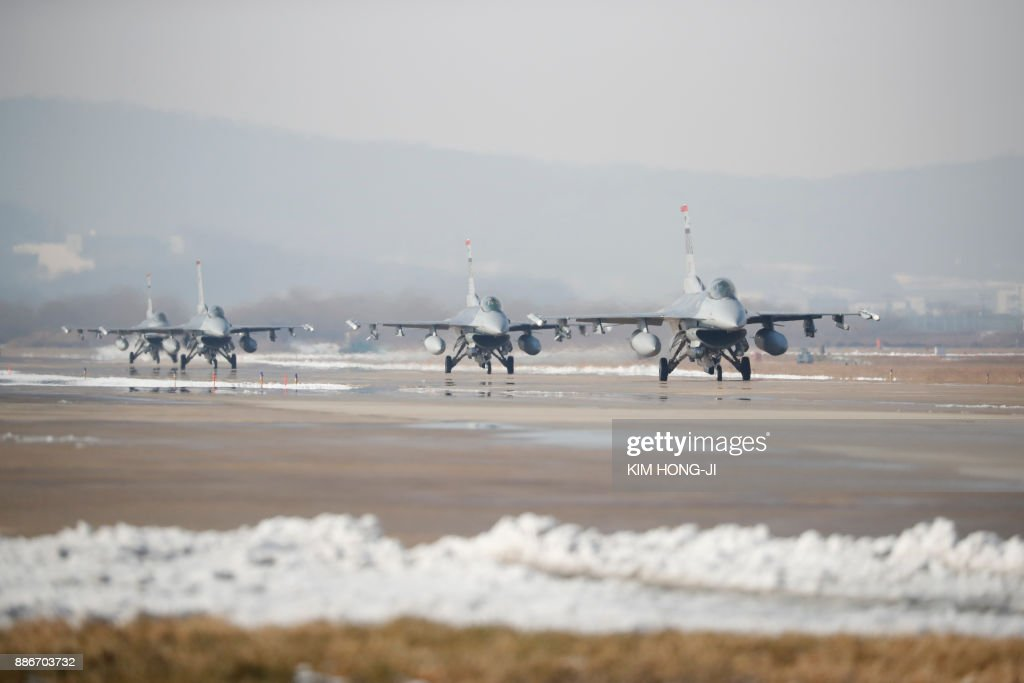 US Air Force F-16 fighter jets take part in a joint aerial drills called 'Vigilant Ace' between the US and South Korea at the Osan Air Base in Pyeongtaek on December 6, 2017. The US and South Korea on December 4, kicked off their largest ever joint air exercise, an operation North Korea has labelled an 'all-out provocation', days after Pyongyang fired its most powerful intercontinental ballistic missile. /