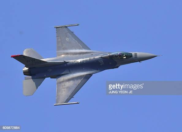 US Air Force F16 Fighting Falcon performs during 'Air Power Day' preview at US Osan Air Base in Pyeongtaek on September 23 2016 An American strategic...