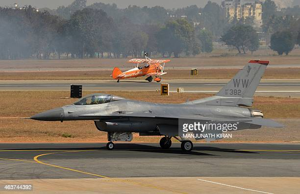 Air Force F16 prepares to take off at Yelahanka Airforce Station in Bangalore on February 18 on the inaugural day of Aero India 2015 Prime Minister...