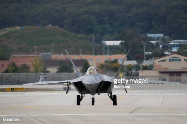 A US Air Force F22 Raptor fighter jet manufactured by Lockheed Martin Corp taxing along tarmac during a press day of the Seoul International...