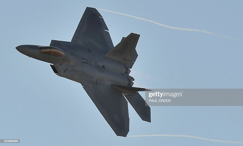 Air Force F-22 Raptor roars through the sky during the Australian International Airshow in Melbourne on March 1, 2013. 180,000 patrons are expected through the gates over the duration of the event staged at the Avalon Airfield some 80kms south-west of Melbourne. AFP PHOTO / Paul CROCK