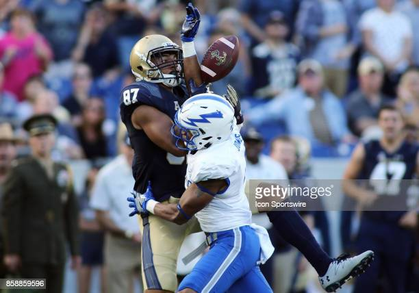 Air Force Falcons defensive back James Jones breaks up a pass play intended for Navy Midshipmen wide receiver Brandon Colon during a match between...