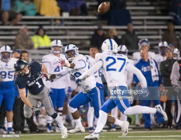 Air Force Falcons defensive back Kyle Floyd and Air Force Falcons defensive back Jeremy Fejedelem prevent Nevada Wolf Pack wide receiver McLane...
