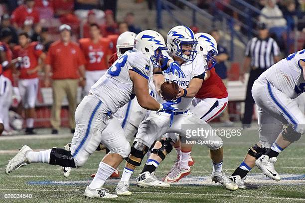 Air Force Falcons quarterback Nate Romine hands the ball off to Air Force Falcons running back Timothy McVey during the Fresno State Bulldogs and the...