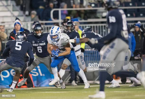 Air Force Falcons running back Timothy McVey is surrounded and taken down by a group of Nevada wolf pack players during the game between the Nevada...