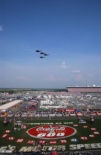 Air Force fighter jets make a flyover prior to the start of the NASCAR Winston Cup CocaCola Racing Family 600 at the Lowe's Motor Speedway in...