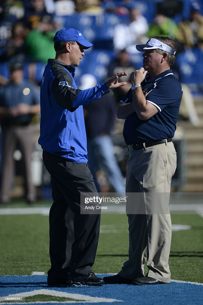 Air Force head coach, Troy Calhoun, left, talks with Notre Dame head coach, Brian Kelly, at mid-field before the game at Falcon Stadium Saturday afternoon, October 26, 2013.