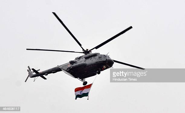 Air Force helicopter fly over the Rajpath during the full dress rehearsal for Republic Day Parade on January 23 2014 in New Delhi India A large crowd...
