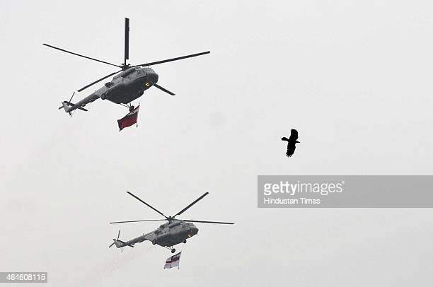 Air Force helicopters fly over the Rajpath during the full dress rehearsal for Republic Day Parade at Rajpath on January 23 2014 in New Delhi India A...