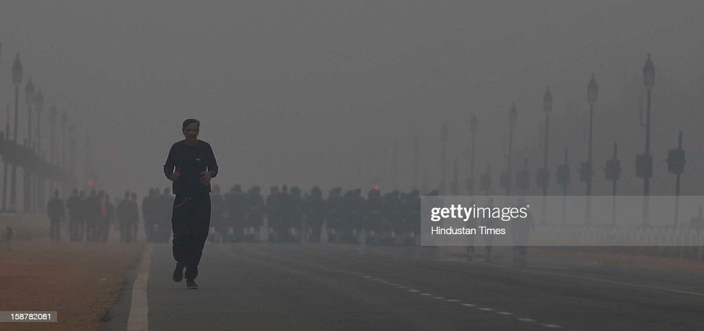 Air force jawans Rehearsal for Republic day in the foggy morning at Rajpath on December 28, 2012 in New Delhi, India. While the maximum temperature was recorded at 19 deg C, up from yesterday's temperature by 2.4 degrees, the minimum temperature today dipped to 6.3 deg C, a degree below the normal.