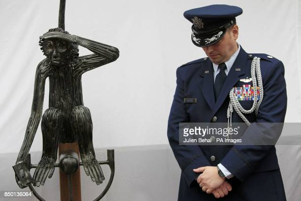US Air Force LieutenantColonel Sean Cosden of the US Defence Attache stands in the garden of O'Donovan's Hotel during the unveiling of the statue of...