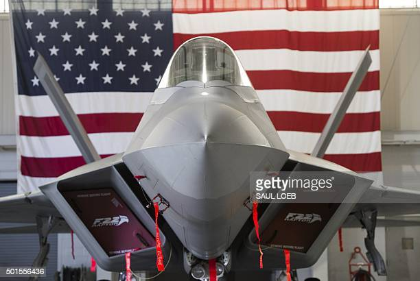 Air Force Lockheed Martin F22 Raptor stealth fighter aircraft is parked inside a hangar during the inaugural Trilateral Exercise between the US Air...