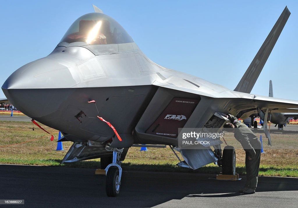 US Air Force Lt Col Jeff Hawkins of the 94th Fighter Squadron inspects a F-22 Raptor during the Australian International Airshow in Melbourne on March 1, 2013. 180,000 patrons are expected through the gates over the duration of the event staged at the Avalon Airfield some 80kms south-west of Melbourne. AFP PHOTO / Paul CROCK