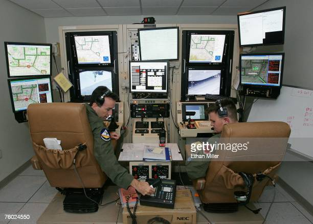 S Air Force Maj Casey Tidgewell and Senior Airman William Swain operate an MQ9 Reaper from a ground control station August 8 2007 at Creech Air Force...