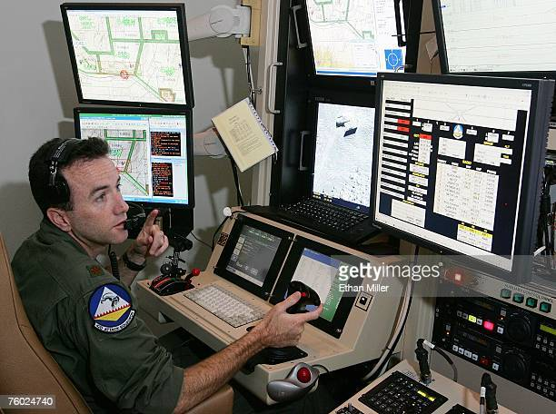 S Air Force Maj Casey Tidgewell pilots an MQ9 Reaper on a training mission from a ground control station August 8 2007 at Creech Air Force Base in...
