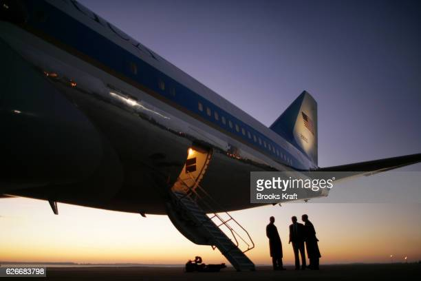 Air Force military personnel wait for the arrival of President Bush at the tail of Air Force One before departure for a 4 day trip to Europe and the...