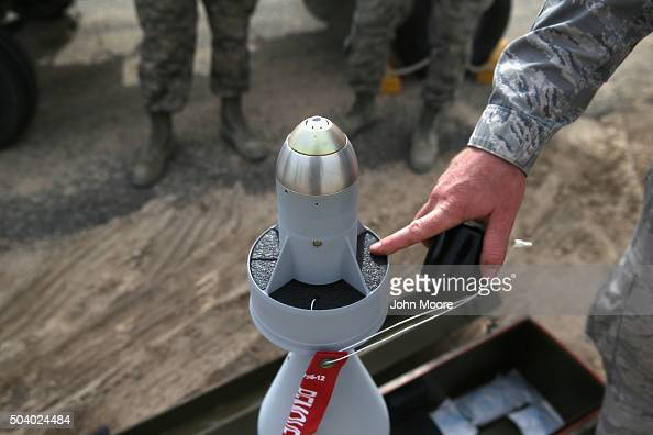 S Air Force munitions team member shows off the laserguided tip to a 500 pound bomb on January 8 2016 at a base in the Persian Gulf Region The US...