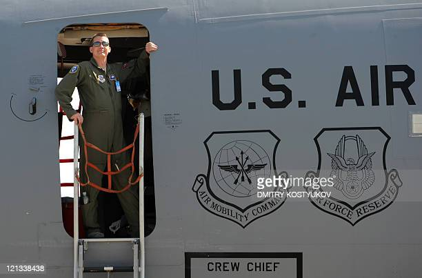 Air Force officer stands in his Boeing C17 as he takes part in MAKS2011 the International Aviation and Space Show in Zhukovsky outside Moscow on...