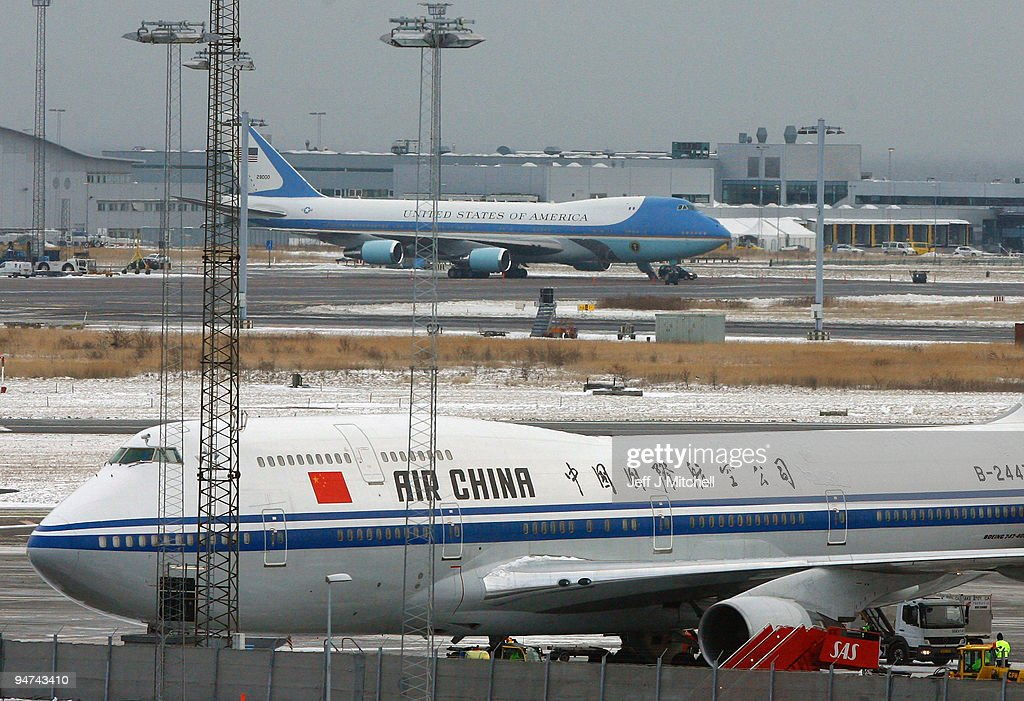 Air Force One and the plane of Chinese Prime Minister Wen Jiabao wait on the tarmac along with other aircraft waiting to return World leaders home, after their attendance at the UN Climate Change Conference on December 18, 2009 in Copenhagen, Denmark. World leaders will try to reach agreement on targets for reducing the earth's carbon emissions on this last day of the summit.
