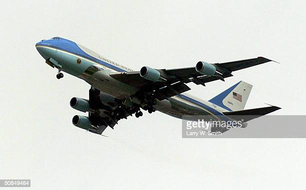 Air Force One flies over the crowd in front of the Monroe Elementary School May 17 2004 in Topeka Kansas President Bush helped celebrate the 50th...