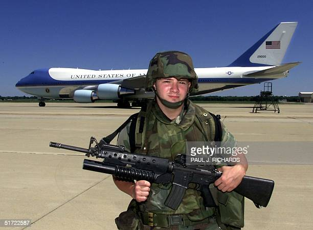 Air Force One is surrounded by armed guards at Barksdale AFB in Shreveport Louisiana 11 September 2001 after leaving Sarasota Florida US President...