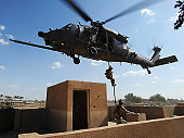 April 10, 2009 - A U.S. Air Force Pararescuemen fast ropes from an HH-60 Pave Hawk helicopter during a proficiency exercise outside of Baghdad, Iraq, in support of Operation Iraqi Freedom.