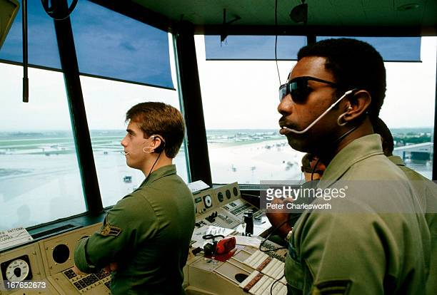 US air force personnel in the control tower watch F4 fighter aircraft take off and land at Clark Air Base one of the United States' military bases in...